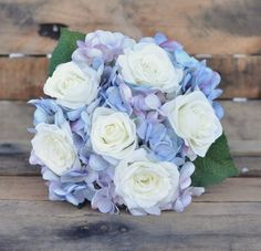 Lovely bouquet in hues of blue and lavender with ivory roses.  Holly's Flower Shoppe on Etsy. See more here: http://www.hollysweddingflowers.com