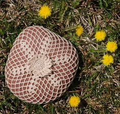Sunflake III Rock...This looks like a fairly large rock that has been covered with crochet!..I love this kind of rock art!!..The greatest thing is that there is a free pattern so I can make it for my flowers!! Thanks so.o much for sharing!!