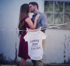 Baby expecting announcement image that had written on a white onesie, 'Coming soon, 11.01.2015'