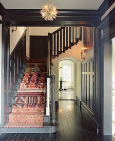 This black wood is perfection.  I love leaving the stair spindles white.  This is going on my to do list.