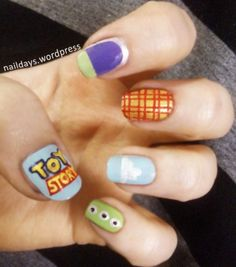 Toy Story nail art, with the logo, a Buzz nail, Woody's cowboy print, the Toy Story cloud and the aliens :)