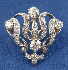 Edwardian Diamond Pendant/Brooch, Tiffany & Co., prong and bead-set with old European-cut diamonds, approx. total wt. 2.35 cts., platinum-topped gold mount, lg. 1 1/8 in., signed.