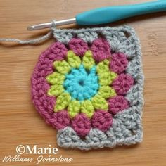 Crochet Granny Square Patterns Making granny square corners with your crochet. - I've stuck to a simple and easy free sunburst granny square crochet pattern that is super fast to work up. It uses only basic stitches that are … Granny Square Crochet Pattern, Crochet Squares, Crochet Blanket Patterns, Crochet Motif, Crochet Designs, Crochet Stitches, Knitting Patterns, Crochet Pillow, Crochet Flower