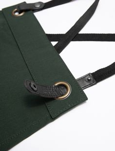 The Tom Bib Apron in Forest with Black Straps takes sophistication to a new level. Designed in our shorter, edgier length, it is the perfect apron for crews on the go Victorian Aprons, Work Aprons, Toms Shoes Outlet, Bib Apron, Apron Designs, Canvas Leather, Sewing Crafts, Belt, Purses