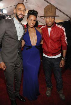 Swizz Beatz, Alicia Keys and Pharrell Williams arriveat the 56th Annual GRAMMY Awards on Jan. 26 in Los Angeles
