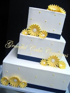 Simple Elegant White Butter Cream Wedding Cake with Yellow Daisies and Navy Blue Ribbon
