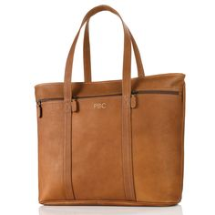"""Dorado Vaqueta Leather Business Tote. Rugged Colombian Vaqueta leather has a soft hand and natural finish that will develop a distinctive patina over time. Accented with antiqued brass hardware. Sized and styled to carry the day for work or weekend. Leather crafted with a top zip closure and lightly padded shoulder straps. Tan. 21"""" x 14"""" x 5"""". Reg. $250.00 SALE $149.99"""