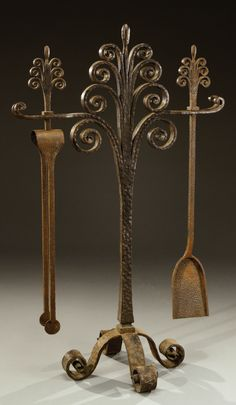 """EDGAR BRANDT A hammered wrought iron fireplace kit with an openwork floral motif upright holding a shovel and  tongs. Engraved intaglio stamp """"E.Brandt"""". Circa 1925. H : 43 ¼ in  