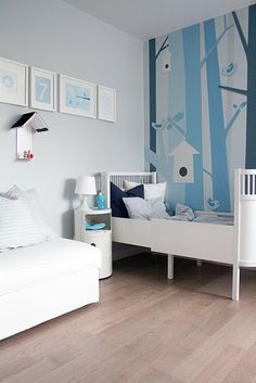 Boy bedroom with painted tree wall. My sister loves birds and would love this if she has a baby boy one day :)