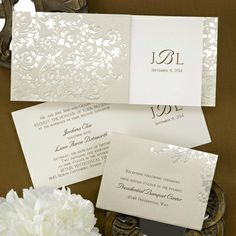 This golden invite features a golden wrap with a filigree design! The tea-length, ecru invitation card has the bride and ...