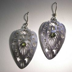 Pierced Sterling silver earrings with 5mm Peridot cabachons. | Nancy LT Hamilton
