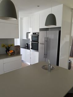 Handle less design. This kitchen done by one of our clients features white high gloss and makes use of finger grooves in order to obtain a clean look without loosing any practicality. Cabinet Doors, High Gloss, Finger, Kitchens, Kitchen Cabinets, Handle, Cleaning, Furniture, Design
