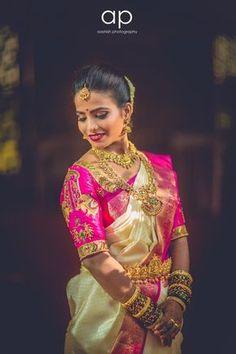 South Indian bride. Gold Indian bridal jewelry.Temple jewelry. Jhumkis. Pink and cream silk kanchipuram sari.Braid with fresh jasmine flowers. Tamil bride. Telugu bride. Kannada bride. Hindu bride. Malayalee bride.Kerala bride.South Indian wedding.
