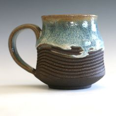 Wide base and narrow opening, visual interest around the base, beautiful glaze