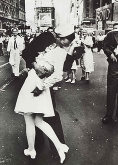 V-J Day in Times Square, a photograph by Alfred Eisenstaedt, was published in Life in 1945 with the caption, In New York's Times Square a white-clad girl clutches her purse and skirt as an uninhibited sailor plants his lips squarely on hers