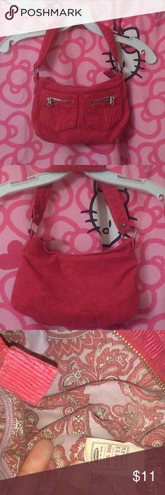 Small Purse Old Navy brand.  Small purse. Great condition.  Gently used. Hot pink corduroy.  Zipper closure.  2 front pockets each have a workable zippered pocket (4 outer pockets total, see last pic).  One pocket inside.  Purple lining with pink & paisley print.  Very cute & durable.  Great for any age,  even a good starter purse.  Easy to clean. Will provide measurements upon request.  Custom bundle for better discount.  I live to trade.  Check out the rest of my closet.  Most prices…