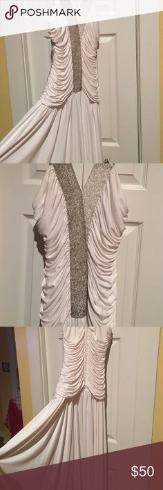 White floor length evening dress Size 6/7 This dress you will feel like your the Prettiest Lady of the occasion. Great for weddings to attend or Upcoming Proms. Or Spring events and Gala's top with beading is lined.spaghetti straps. Was used in a photo shoot. Dresses Wedding