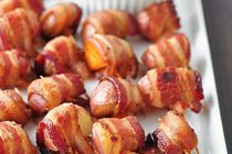 JC says: I'm going to try these grilled with a little maple smoke. Bacon-Wrapped Potato Bites with Spicy Sour Cream Dipping Sauce