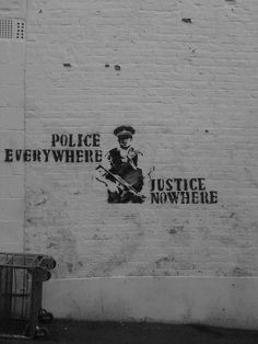 """Banksy,,,, must be old ? We have NO POLICE - yeah really old I can't remember """"Justice"""""""