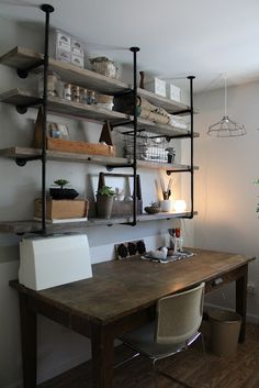 Industrial Pipe Shelves by SylvieLiv: Before & After: Craft Room`  Check w/ hubby to see if this is what he'd like in the