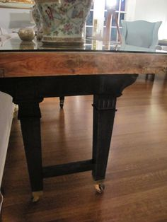 Vintage Century Designs~~~an old door with piano legs, a piece of glass= vintage table