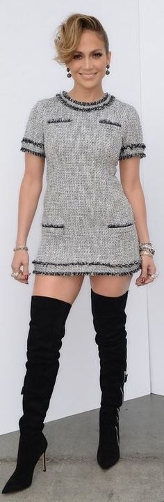 Who made  Jennifer Lopez's black thigh high boots and gray tweed short sleeve dress?
