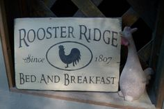 Primitive hand painted Rooster Ridge bed and breakfast sign, primitive sign, rustic farmhouse decor, weathered barn wood, ready to ship. $7.50, via Etsy.