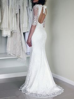 Lace wedding dress in a trumpet silhouette with open back and 3/4 sleeves made using the luxurious Chantilly lace - shown in the first picture of