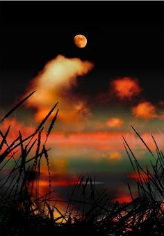 Moon and crimson clouds over a dark, serene lake