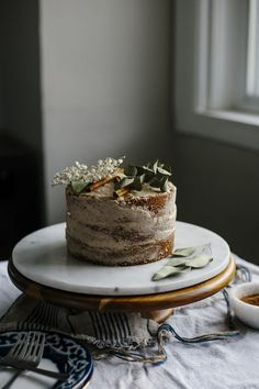 Vegan Vanilla Cake | Make this 3-tier vegan vanilla cake topped with chai spice icing--super moist and full of flavor! | thealmondeater.com #vegan
