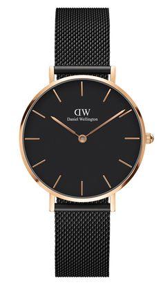 Daniel Wellington Horloge Classic Petite Ashfield 32 mm DW00100202. Elegant en trendy vormgegeven horloge met een ultradunne kast van 6 mm. De zilverkleurige, stalen kast heeft een doorsnee van 32 mm en is voorzien van een zwarte wijzerplaat voorzien van zilverkleurige index en wijzers. Dit model heeft een zwarte Milanese (mesh) horlogeband voorzien van een klepsluiting.