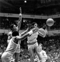 Black and white photo of University of Oregon basketball player Fred Cofield passing the ball against UCLA during a game played at McArthur Court on January 31, 1981 and won by the Bruins 75-69. ©University of Oregon Libraries - Special Collections and University Archives
