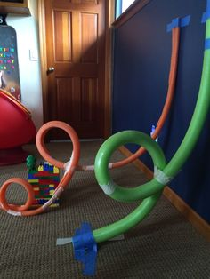 Marble roller coaster track using pool noodles and masking/painters' tape. STEM kid engineering roller coaster pool noodle marble