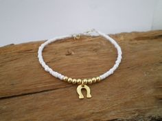 Tiny beaded bracelet & horseshoe friendship bracelet by GerasimoS, €12.00