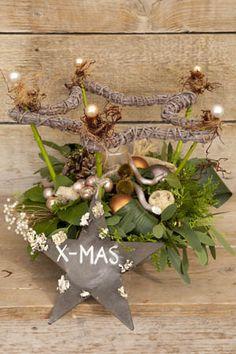 kerststuk met kerststerren