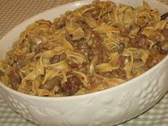 Crock Pot Beef Stroganoff -  1-2 lbs. Stew Meat  1 tsp. Salt  Pepper, to taste  1 Onion, sliced  Garlic Powder, to taste  1 T. Worcestershire Sace  1 T. Ketchup  1 1/2 C. Beef Broth  1/3 C. Flour  1/2 C. Water  8 oz. Fresh Sliced Mushrooms  1/2 C. Sour Cream
