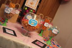 Gold fish bar at Bubble guppies themed second birthday party!! Made with dollar store bowls and candle sticks!!