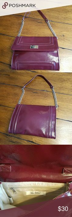 """Nine West Purse/clutch Fabulous Burgundy Authentic NINE WEST Purse with magnetic closure. Strap can be concealed, so dpubles as clutch! Chain strap (9.5 """" drop) one interior zip pocket.  9.5"""" long, 7"""" tall, 2"""" depth. Excellent condition. No flaws. I'm a suggested user & top rated seller open to negotiating prices and give great bundle deals. Use the offer button & don't hesitate to ask questions. :) Xoxo Ansley Nine West Bags Shoulder Bags"""