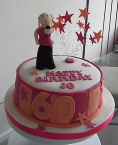 a 60th birthday cake for a lady who likes karaoke