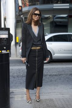 sleek midi skirt with a slouchy sweater plus a chic pumps