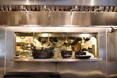 A stainless steel window into the kitchen, where chef Justin Simoneaux prepares plates.