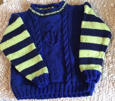 Hand knit child's sweater. Nautical look. size 6-8 100% washable wool. Machine wash, dry flat