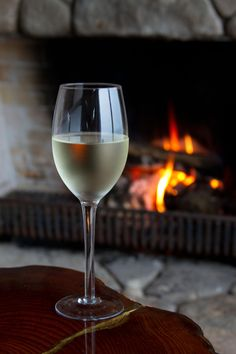 *Enjoying a glass of wine by the fireside.