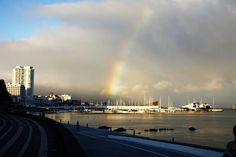 A rainbow appears as storm clouds recede over the marina at Ponta Delgada on the island of San Miguel in the Azores
