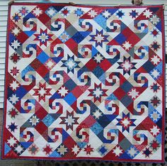 The Stars Sing (pattern is called Jewel of the Prairie by Judy Martin). This pattern is a variation by Judy on her Shakespeare in the Park design, and it appeared in Love of Quilting magazine. Flag Quilt, Patriotic Quilts, Star Quilts, Scrappy Quilts, Quilt Blocks, Quilting Projects, Quilting Designs, Quilting Ideas, Sewing Projects