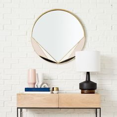 Deco chic meets modern sleek in our Deco Brass Mirror with geo enamel accents. The perfect size to make a statement in a bedroom, entryway, living room or bathroom, this round mirror features enameled shapes outlined in brass.