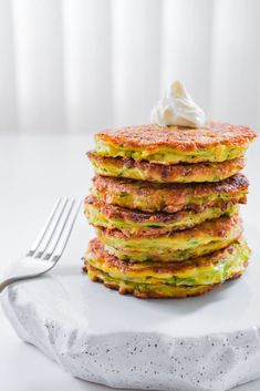 These fluffy zucchini pancakes with caramelized scallions and Gruyere cheese are tender, flavorful and delicious.