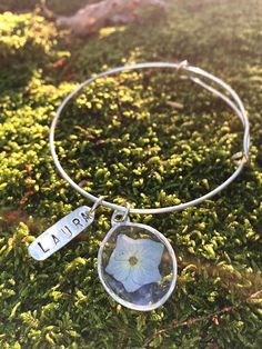 Sterling silver Real blue Hydrangea flower in ice resin charm bracelet with personalized hand hammered name tag . by MangoLillyandRose on Etsy https://www.etsy.com/listing/268666320/sterling-silver-real-blue-hydrangea