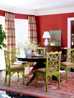 Red dining room with green chairs and leopard print