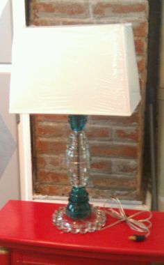 I love making lamps out of old glass insulators!!